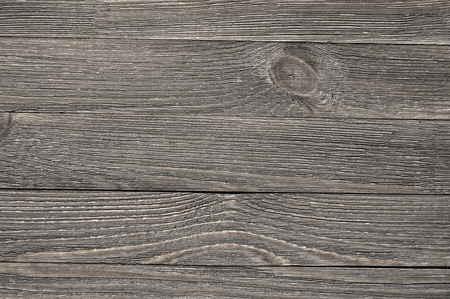 Natural knotted gray weathered wood plank texture background. photo