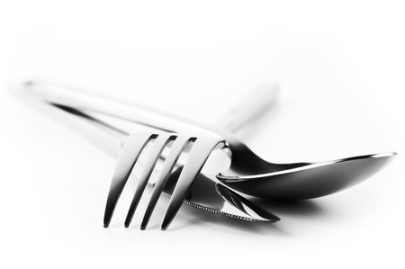 Cutlery set: fork, spoon and knife isolated on white background. Soft focus, shallow DOF. High contrast. photo