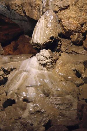 stalagmite: Speleothems in solutional karst cave. Kizil-Koba (Red cave), Crimea. Shallow DOF.