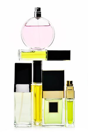 Various woman perfumes set isolated on white background. photo