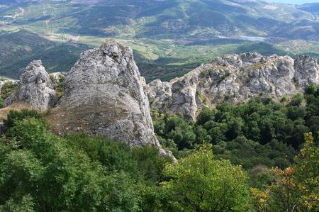 scarp: Peaked rocks over valley. Crimea.