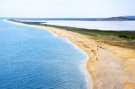 to spit: Spit between coastal salty lake Koyashskoye and sea in Crimea.