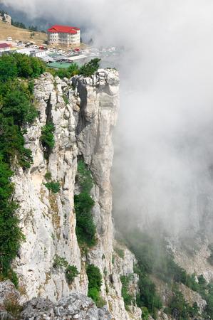 steep cliff: Village on steep cliff in fog. Ai-Petri, Crimea.