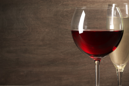 glass  reflection: Glasses of red and white wine close-up on wooden background with copy space. Shallow DOF. Stock Photo