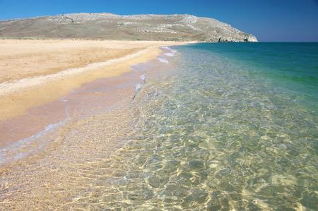 crystalline: Sand beach, coastline and crystalline clear water in sea.