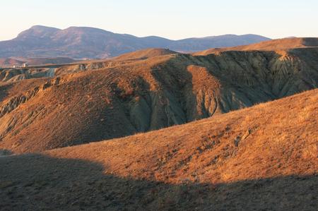 flexure: Hilly relief at sunset. Cape Meganom, Crimea. Stock Photo