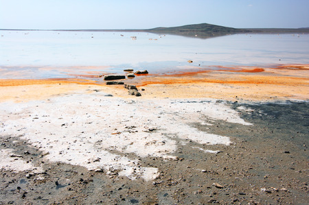 crystallized: Unusual Koyashskoye salt lake with crystallized salt orange color as result of carotene released of microscopic algae and healing mud. Crimea.