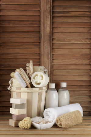 bath: Set of bath accessory in wooden bathroom. Stock Photo