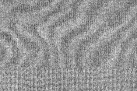 plain stitch: Melange gray woolen knitted fabric as background.