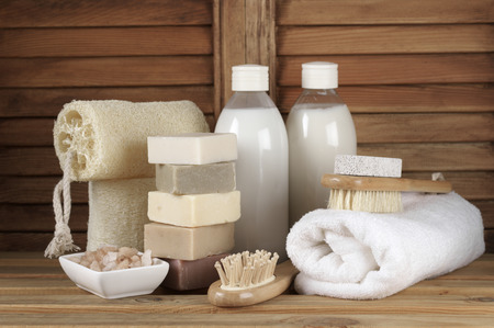 Set of bath accessory in wooden bathroom. Stock Photo
