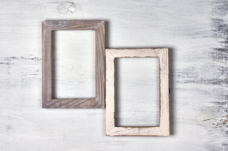 Two vintage wooden photo frames on shabby painted wood background. 写真素材