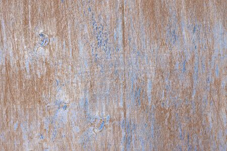 scratches: Shabby weathered wood texture as background. Brown wood with remains of blue paint and scratches. Stock Photo