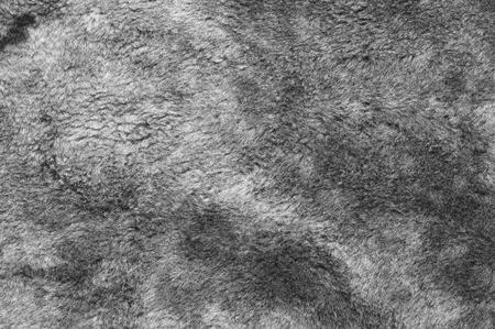 sheepskin: Natural gray sheepskin fur texture as background. Stock Photo