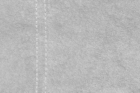 chamois leather: Natural light gray suede texture with stitch as background. Stock Photo