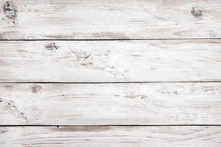 distressed wood: Vintage weathered shabby white painted wood texture as background.