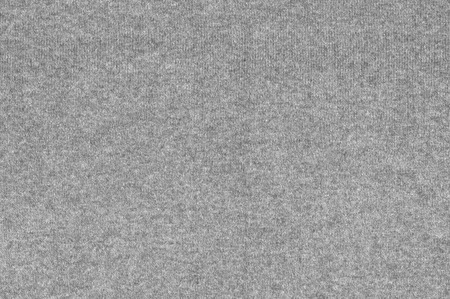 woolen: Melange gray woolen knitted fabric as background.