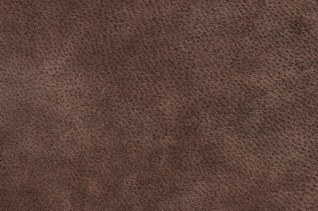chamois leather: Natural dark brown suede texture as background.