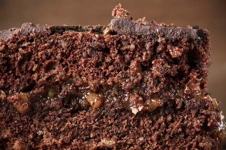 ultimate: Piece of homemade ultimate chocolate cake close-up. Stock Photo