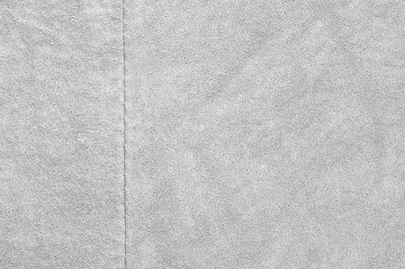chamois leather: Natural light gray suede texture with rub as background. Stock Photo