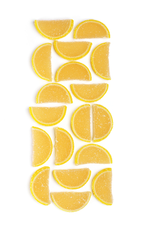 sweetstuff: Lemon segment shaped candied fruit jelly isolated on white background. Top view point.