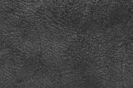 sheepskin: Black sheepskin texture as background.