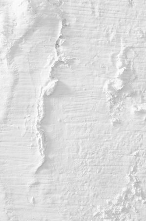 blanch: White distressed weathered whitewashed wall texture close-up.