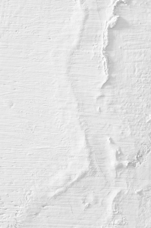 White distressed weathered whitewashed wall texture close-up.