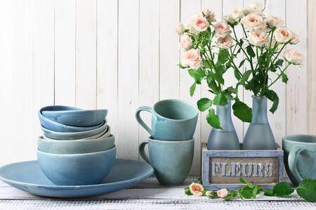 Stack Of Blue Handmade Ceramic Bowls Dish Mugs And Pink Roses