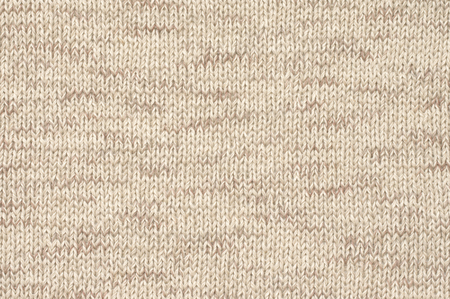 Knitted cloth plain stitch texture of melange neutral colored linen yarn.
