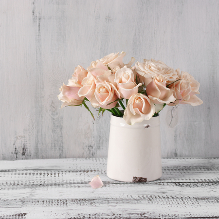 Bouquet Of Delicate Pink Roses In Vintage Tin Vase On White Rustic