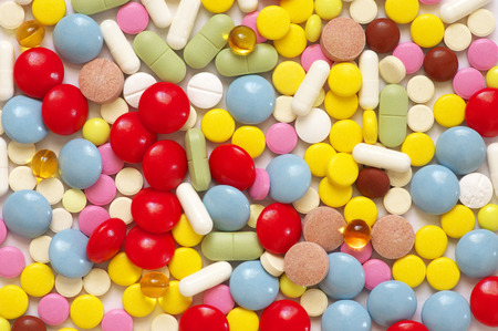 Heap of colorful pills close-up. Top view point. Stock Photo