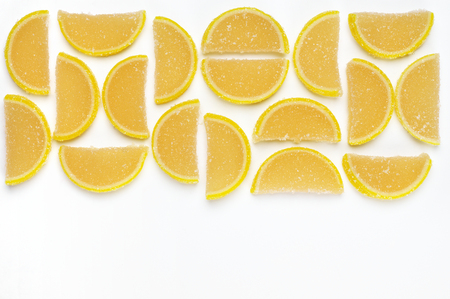 sweetstuff: Lemon segment shaped candied fruit jelly on white background. Top view point.