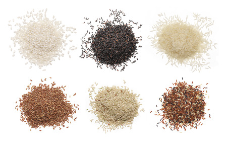 Set of various rice isolated on white background: glutinous, black, basmati, brown and red mixed rice. Top view.