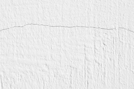 White distressed rough whitewashed wall texture.