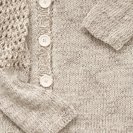 Knitted Cardigan Of Plain Stitch With Openwork Sleeves Close Up