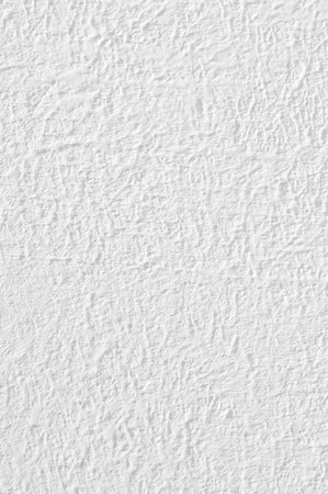 White rough whitewashed wall texture close-up. Banco de Imagens