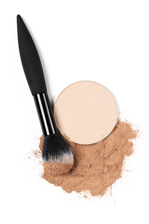 Cosmetic set of compact and loose face powder and makeup brush isolated on white background. Top view point, flat lay. Stock Photo