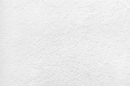 White styrofoam texture close-up as background.