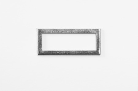 Simple metallic frame on white cardboard background.