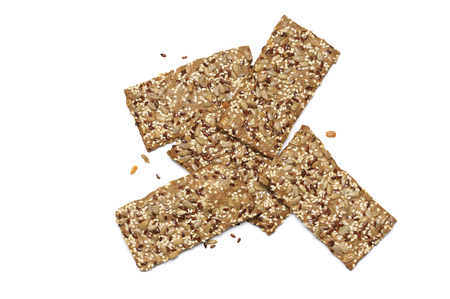 Crispy rye flatbread crackers with sesame and sunflower seeds isolated on white background. Top view point. Reklamní fotografie