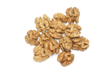 Peeled walnuts isolated on white background. Top view point.