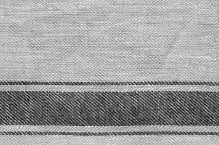 Grey rough linen fabric texture close-up as background.
