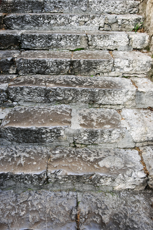 Old rouge grey stone stairway texture.