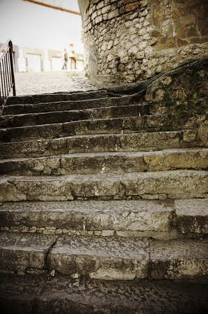 Old rouge stone stairway texture. Vintage filtered image.