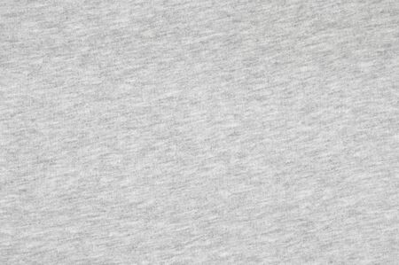 Delicate cotton light grey jersey texture as background. Stock Photo