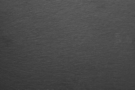 Dark grey and black slate texture as background. Stock Photo