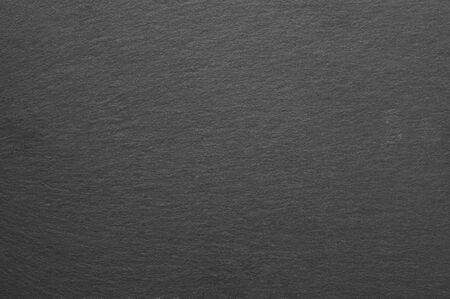 Dunkelgraue und schwarze Schieferbeschaffenheit als Hintergrund. Standard-Bild