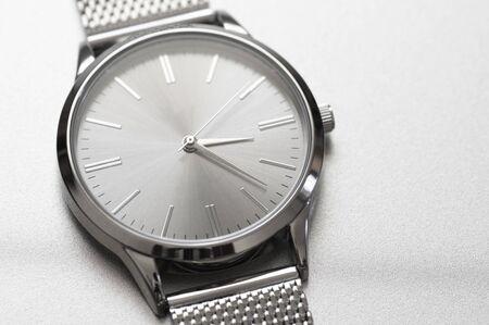 Minimalist classic steel wrist watch closeup on metallic background.  Stock Photo