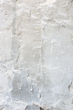 Distressed rouge plaster texture as background. Imagens