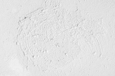 White distressed rough whitewashed wall texture as background. Banco de Imagens